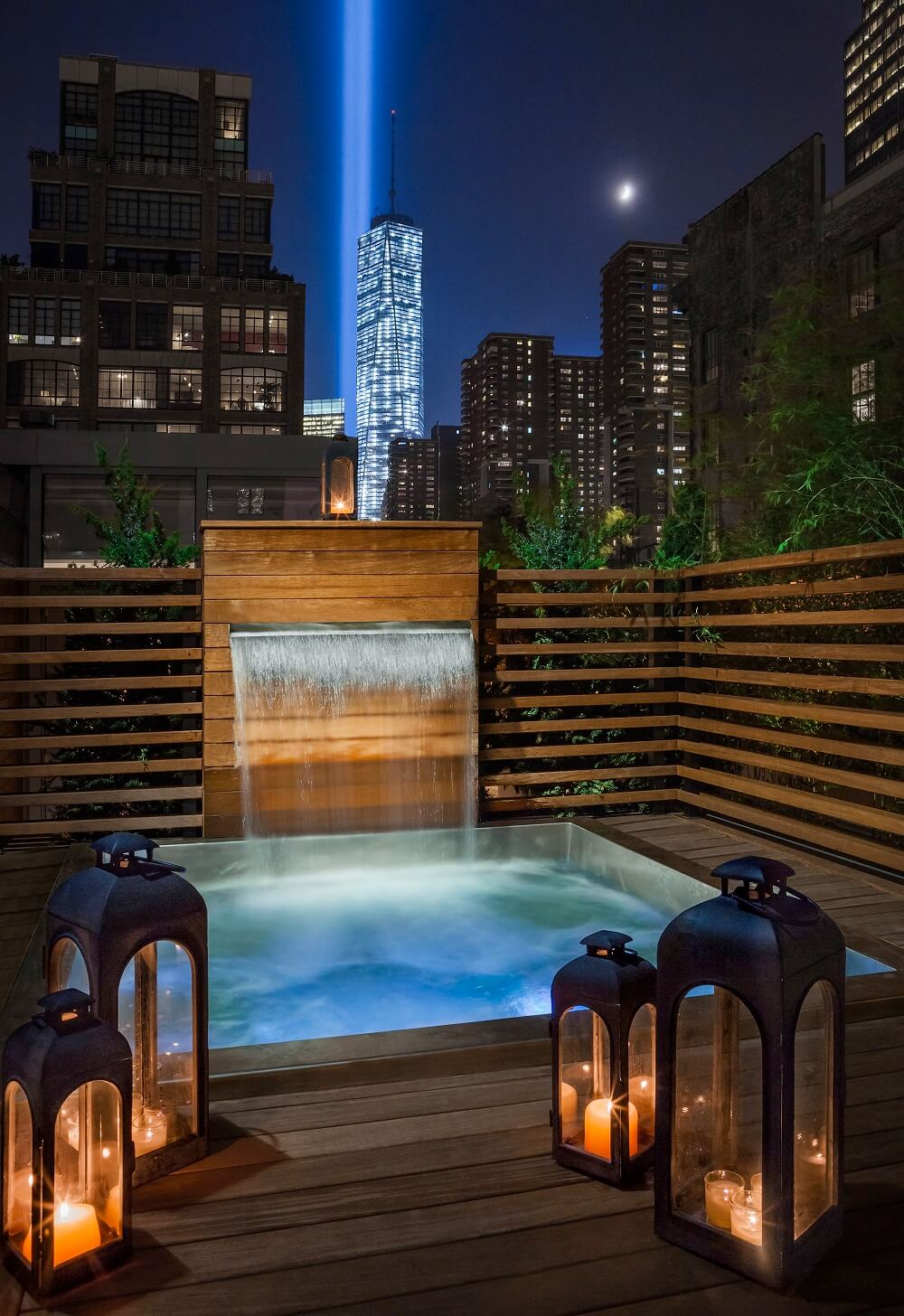 """Custom Stainless Steel Spa 81"""" x 87"""" x 42"""" with bench seating.  Custom stainless steel water feature 40""""x 67"""" with a 36"""" water spout."""